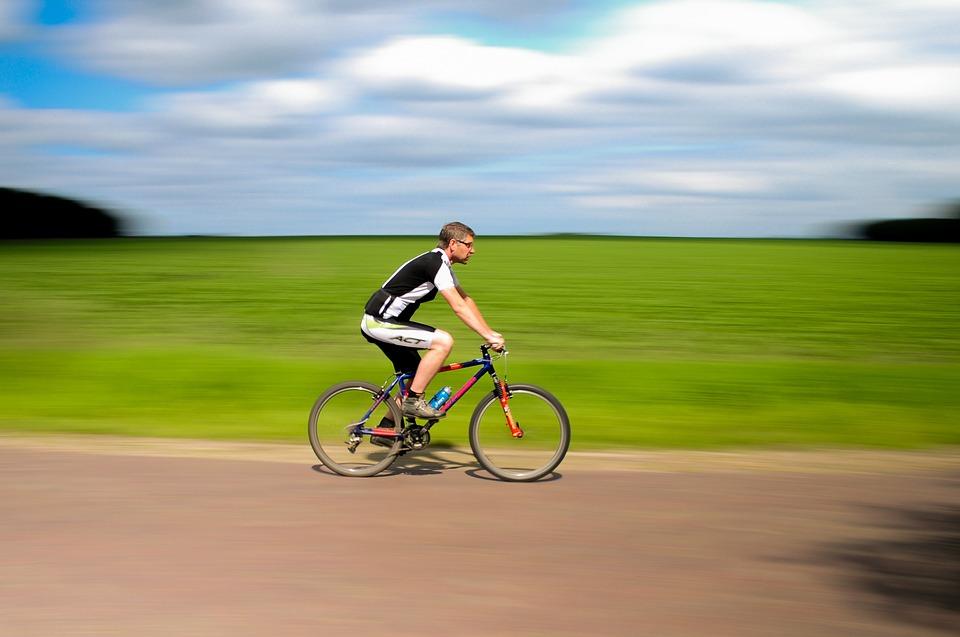 Man on bike speeding past