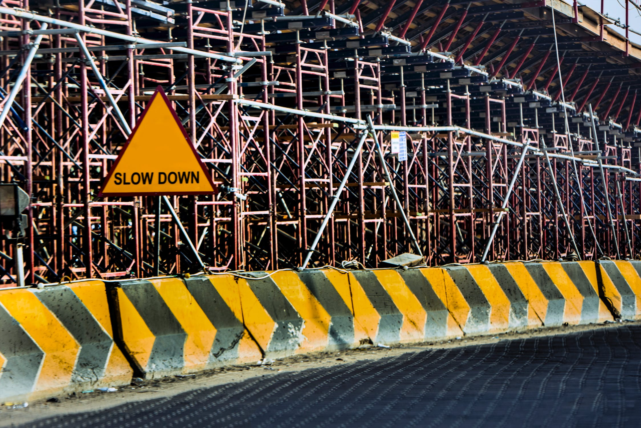 Sign on construction site telling cars to slow down