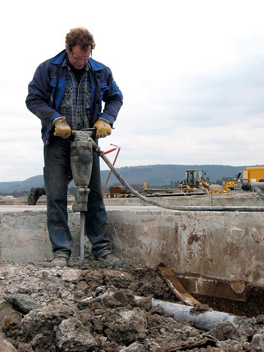Construction worker using a jackhammer